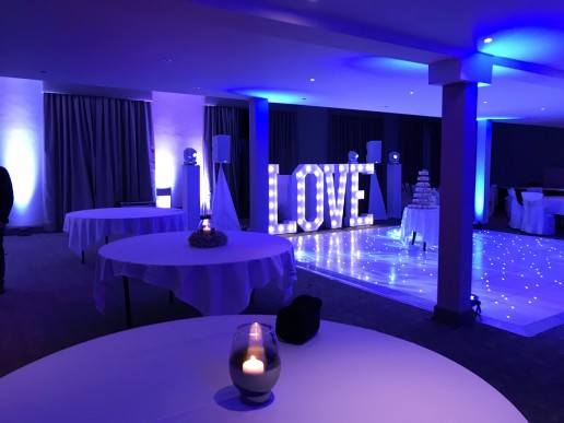 White dance floor with LOVE letters in the courtyard at Walton Hall
