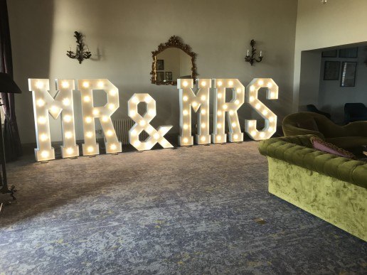 Mr and MRs in the Foyer at Walton Hall