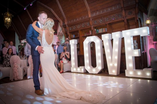 Ettington Park, Long gallery first dance with white starlit dance floor and LOVE letters