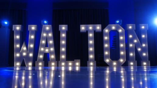 Walton in light up letters with blue moodlighting background